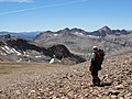 Hiker descends to McGee Pass from Red Slate Mountain (3927613731).jpg