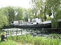 Houseboat on the Chichester Ship Canal at Birdham, West Sussex.jpg