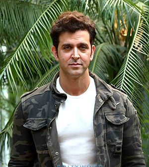 Hrithik Roshan is looking towards the camera.