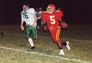 High school football - A running back sweeps the left end during a high school football game near Cincinnati, Ohio, 1999