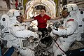 ISS-60 EVA-1 (a) Christina Koch with spacewalkers inside the Quest airlock.jpg
