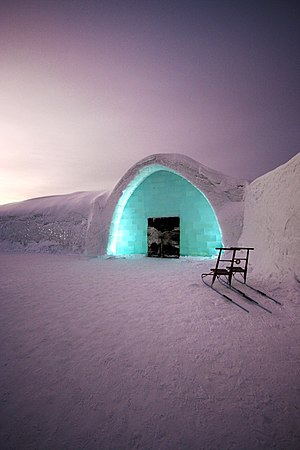 Ice hotel - The entrance of ICEHOTEL in Jukkasjärvi, Sweden, 2007, with two kicksleds outside.