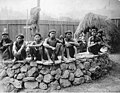 Igorrote men sitting on stone platform inside a replica village at the Lewis and Clark Exposition, Portland, Oregon, 1905 (AL+CA 2284).jpg