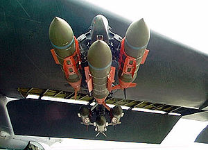 Hardpoint - Three GBU-31 JDAM precision guided bombs on a triple-ejector rack, under the wing of a B-52.