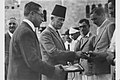 JERUSALEM'S MAYOR RAGEB NASHASHIBI GRANTING MEDALS TO TENNIS PLAYERS AT THE INAUGURATION CEREMONY OF THE Y.M.C.A. TENNIS COURTS, IN JERUSALEM. ראש עירD637-034.jpg