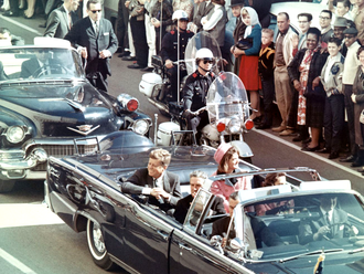 Assassination of John F. Kennedy - President Kennedy with his wife, Jacqueline, and Texas Governor John Connally with his wife, Nellie, in the presidential limousine, minutes before the assassination