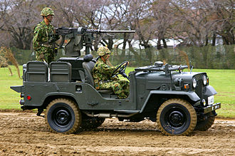 Hit-and-run tactics - A JGSDF military light truck armed with a heavy machine gun at the rear for anti-personnel harassment operations.