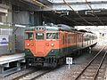 JNR 113 Shonan livery C8 set Sagano Line local at Saga-Arashiyama Station 20080529.jpg