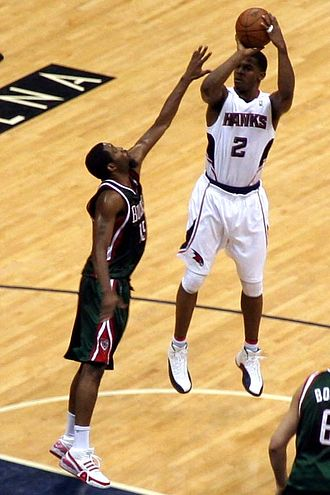 Joe Johnson (basketball) - Johnson with the Hawks in February 2010, shooting over John Salmons of the Milwaukee Bucks