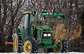 John Deere tractor with cattle feeder.jpg