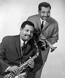 Cannonball (holding a King Super 20 'Silversonic' alto saxophone) with brother Nat Adderley in 1966
