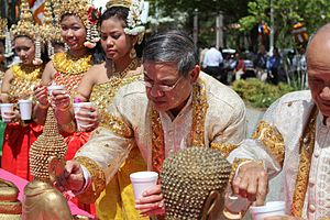 Cambodian New Year - Elders cleanse statues of the Buddha with perfumed water.