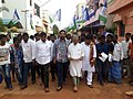 Kotamreddy Sridhar Reddy walking with people to know the issues in nellore.jpg
