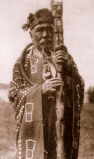 Talking stick - A Kwakwaka'wakw man with a talking stick, photo by Edward S. Curtis
