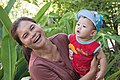 Lao woman laughing holding a baby.jpg