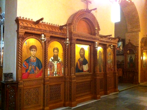 Icon case - Icons inside a larger kiot made for several icons, placed in a church narthex for veneration. Thessaloniki, Greece