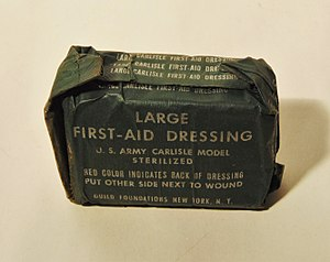 Field dressing (bandage) -  Large First-Aid Dressing, U.S. Army Carlisle Model Sterilized, packed in dark green packaging, rectangular model, New York.