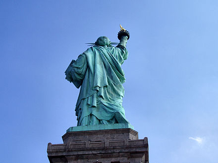 The Statue of Liberty from behind, showing that she is walking forward Liberty-statue-from-behind.jpg
