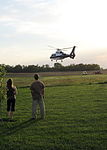 Life Flight ascending from a rural pasture temporary landing zone cleared by EMS.JPG