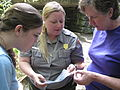 Lily Cason, Emily Guss, and Vicki Pentecost looking at a salamander (4977627344).jpg