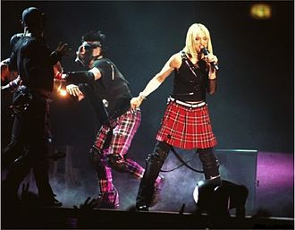 "Music (Madonna album) - Madonna performing promotional single ""Impressive Instant"" during the Drowned World Tour."
