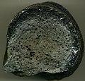 Mafic obsidian rimming vesicular basalt (lava toe from early 1990s Kupaianaha pahoehoe lava flow (East Rift Zone, Kilauea Volcano), town of Kalapana, southeastern Hawaii, USA) (14838721599).jpg