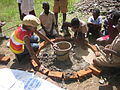 Making concrete slabs for toilets by pupils (5567847846).jpg