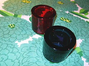 Maija Isola - Tablecloth in Isola's 1974 Primavera pattern (with candleholders designed by Heikki Orvola)