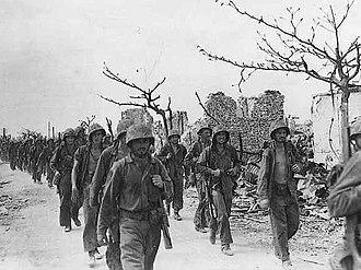 Saipan - Marines march through Garapan, July 1944