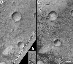 Airy-0 - Three images of Airy-0 taken by, from A to C, Mariner 9, Viking 1 and Mars Global Surveyor. Airy-0 is the larger crater towards the top center in each frame.