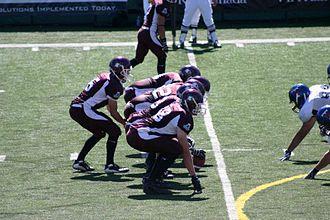 McMaster Marauders football - The McMaster Marauders facing the Toronto Varsity Blues