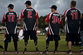 Members of the Wounded Warrior Amputee Softball Team (WWAST) wait to greet members of the Hickam Force and Hickam Chiefs teams during player introductions 130108-F-ZB240-737.jpg