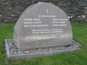 Loughinisland - 1994 memento to villagers, in St McCartan's churchyard, Loughinisland, County Down