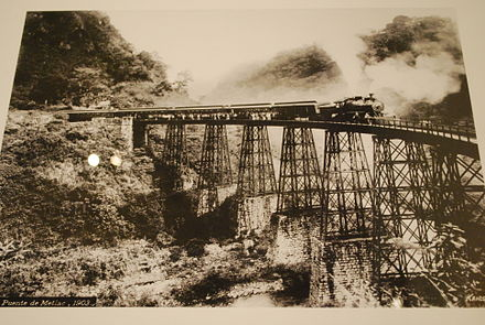 A photo of the Metlac railway bridge, an example of engineering achievement that overcame geographical barriers and allowed efficient movement of goods and people. Photo by Guillermo Kahlo. MetlacBridgeKahlo.JPG