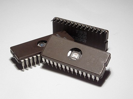 Erasable Programmable Read-Only Memory (EPROM) integrated circuits. These packages have a transparent window that shows the die inside. The window is used to erase the memory by exposing the chip to ultraviolet light. Microchips.jpg