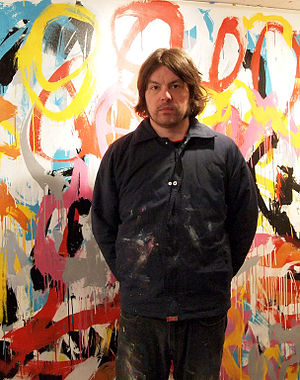 Mikey Welsh - Welsh in front of his artwork in winter 2010