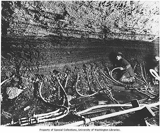 Miners thawing frozen ground with steam in an underground gold mine, Third Beach Line, Nome, 1909 (AL+CA 345)