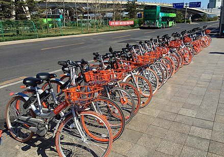 Mobikes on the sidewalks in Beijing Mobikes at the south square of Beijing South Railway Station (20170331103900).jpg