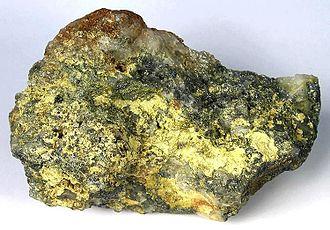 Molybdenum trioxide - Molybdite on molybdenite, Questa molybdenum mine, New Mexico (size: 11.0×6.7×4.1 cm)