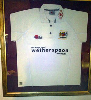 Kings Head Hotel, Monmouth - Monmouth Cricket Club shirt in the hotel with a QRpedia code.