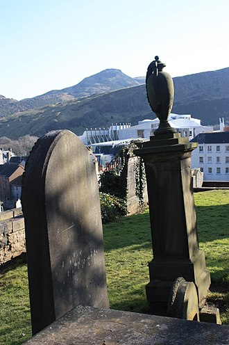 New Calton Burial Ground - Monuments in New Calton Burial Ground with Arthur's Seat and the Scottish Parliament in the background