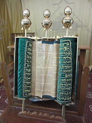 Blue in Judaism - A Samaritan Torah scroll wrapped in blue. Some Samaritan kohens dress in blue or green silk.