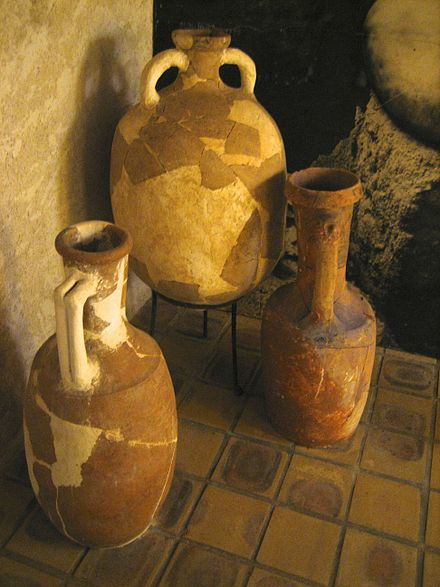 In pre-literate societies, the distinctive shape of amphorae served some of the functions of a label, communicating information about region of origin, the name of the producer and may have carried product quality claims MuseeEmileChenon6716.jpg