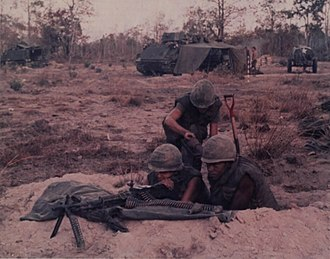 50th Infantry Regiment (United States) - Members of Company A, 1st Battalion, 50th Infantry setting up a M60 machine gun position during a search and clear mission in the Vietnam War, 1970. M113 armored personnel carriers are visible in the background.