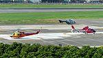 NASC UH-1H NA-516, AS365 NA-101 and Sunrise Airlines Kawasaki BK117-B2 B-77099 at Taipei Songshan Airport 20160821.jpg