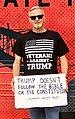 "NC 11th District Morris ""Moe"" Davis holding placard protesting Trump.jpg"