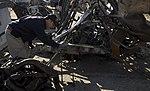 NTSB highway investigator Michael Fox examines mangled truck involved in CA grade crossing accident. (16652006442).jpg