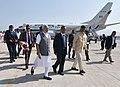 Narendra Modi being welcomed by the Governor of Andhra Pradesh and Telangana, Shri E.S.L. Narasimhan and the Chief Minister of Andhra Pradesh, Shri N. Chandrababu Naidu on his arrival, at Tirupati airport, Andhra Pradesh (2).jpg