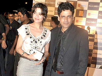 Manoj Bajpayee - Bajpayee with his wife Neha at the Raajneeti premiere, 2010