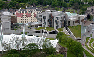 Scottish Parliament Building - An aerial view of the Scottish Parliament Building complex. The red tiles of Queensberry House are visible between the MSP Office block at the back of the complex and the Tower and Canongate Buildings at the front which house the debating chamber and committee rooms.